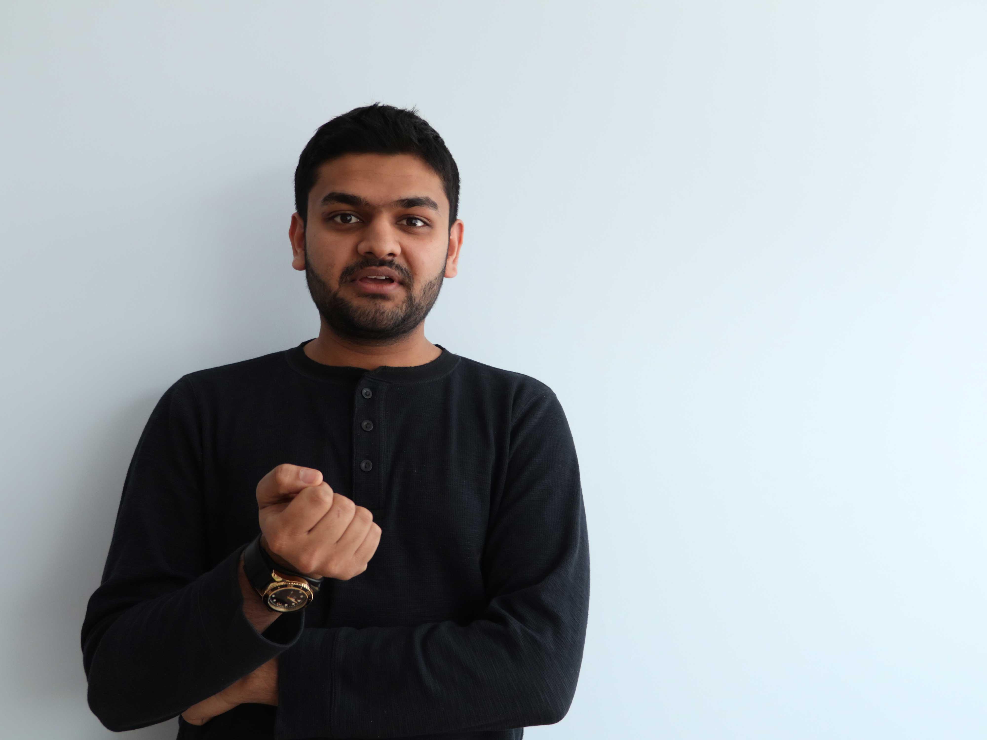 headshot of Ameen Al-Gailani in front of blank wall