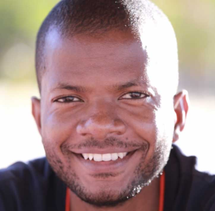 Cropped headshot of James Chirombo with blurred background