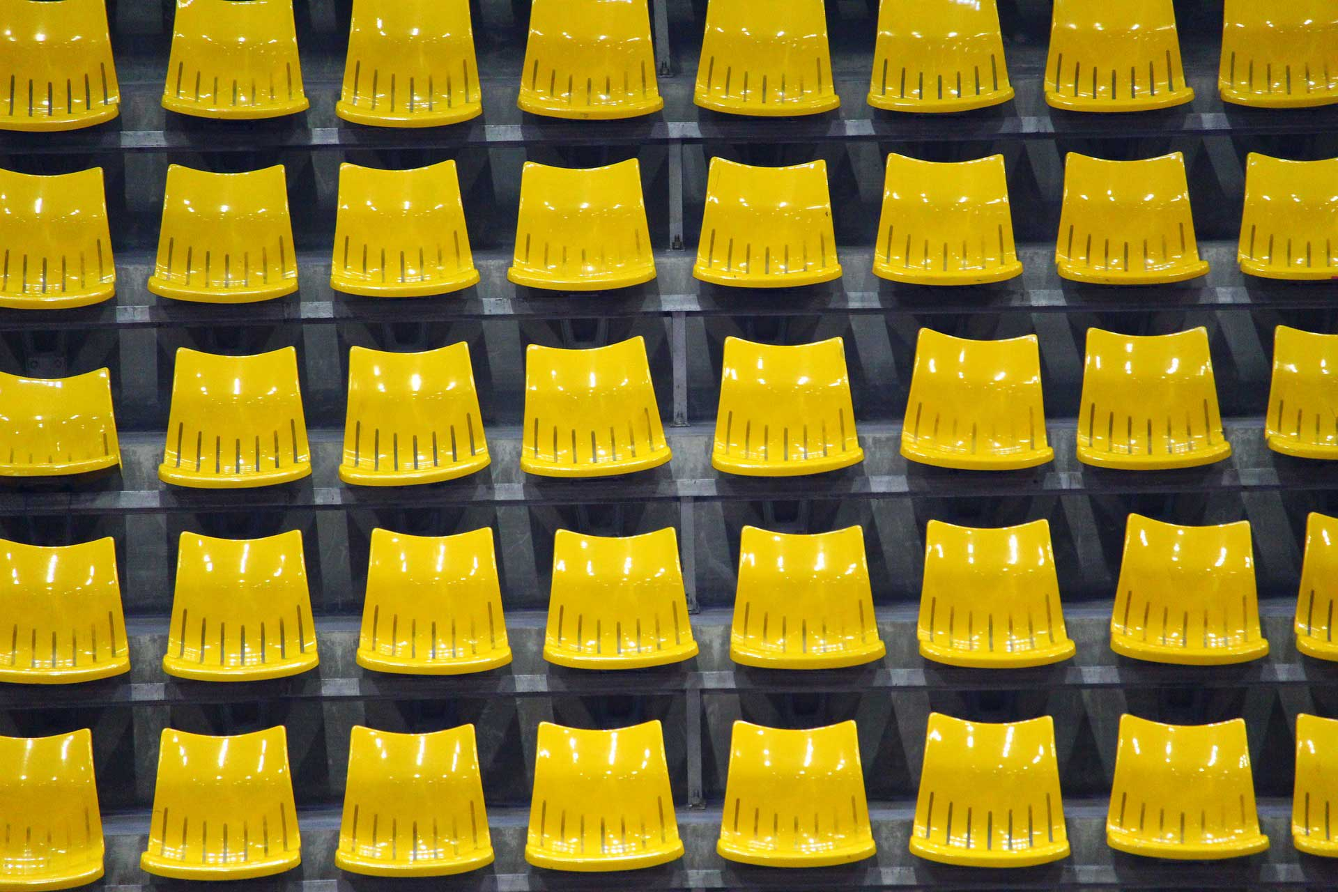 Banner image of yellow chairs aligned in multiple rows and columns