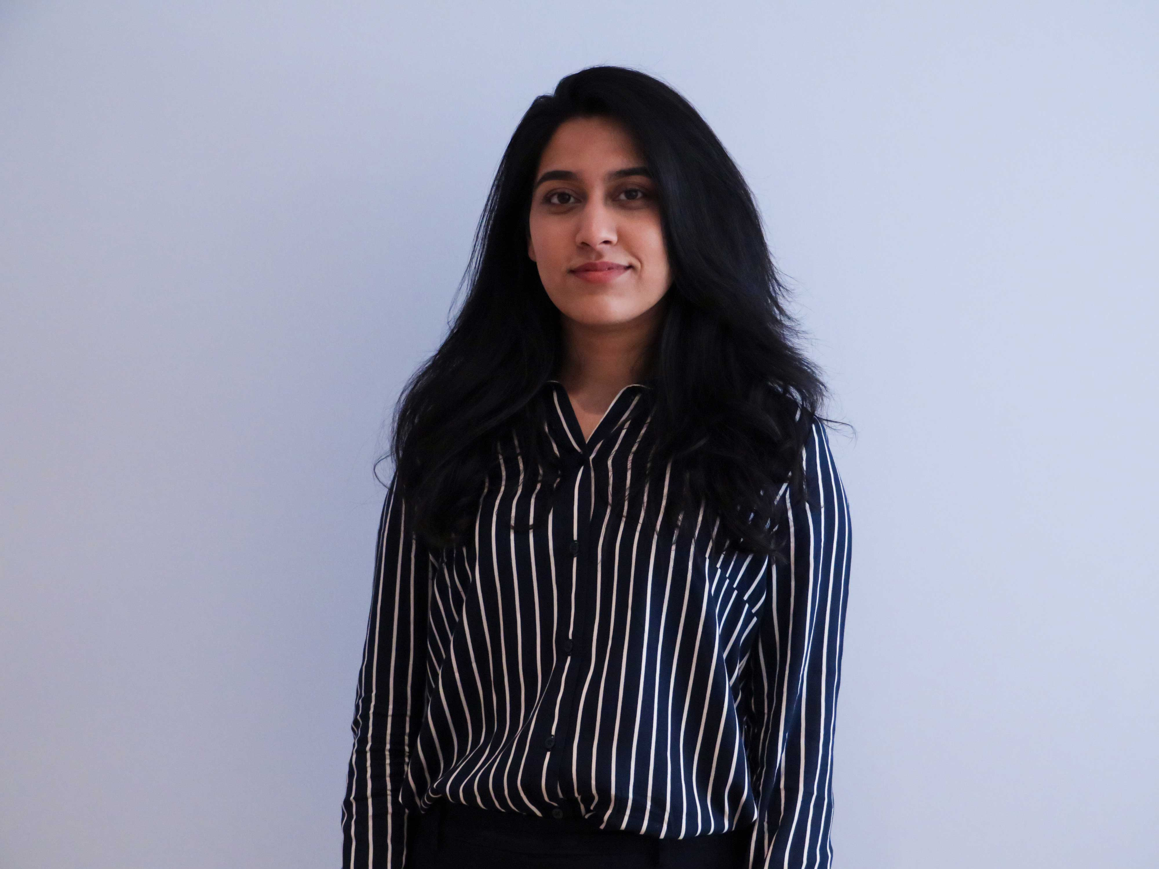 headshot of Ailya Salman in front of blank wall